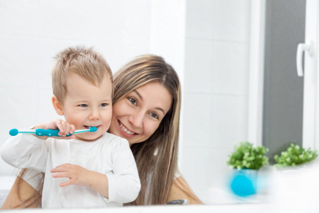 Mom Teaching Kid How To Brush Teeth